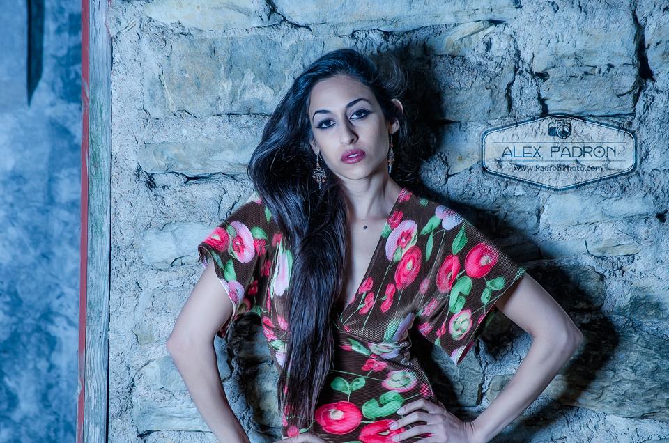 brunette model on brick wall